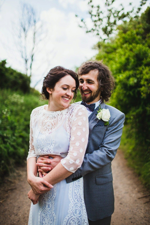 A pale blue wedding dress for a spring time rural wedding wedding