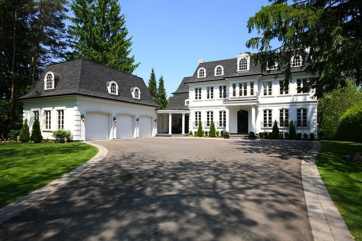 Suzie pricey pads gorgeous mansion with white stone for Stone garage designs