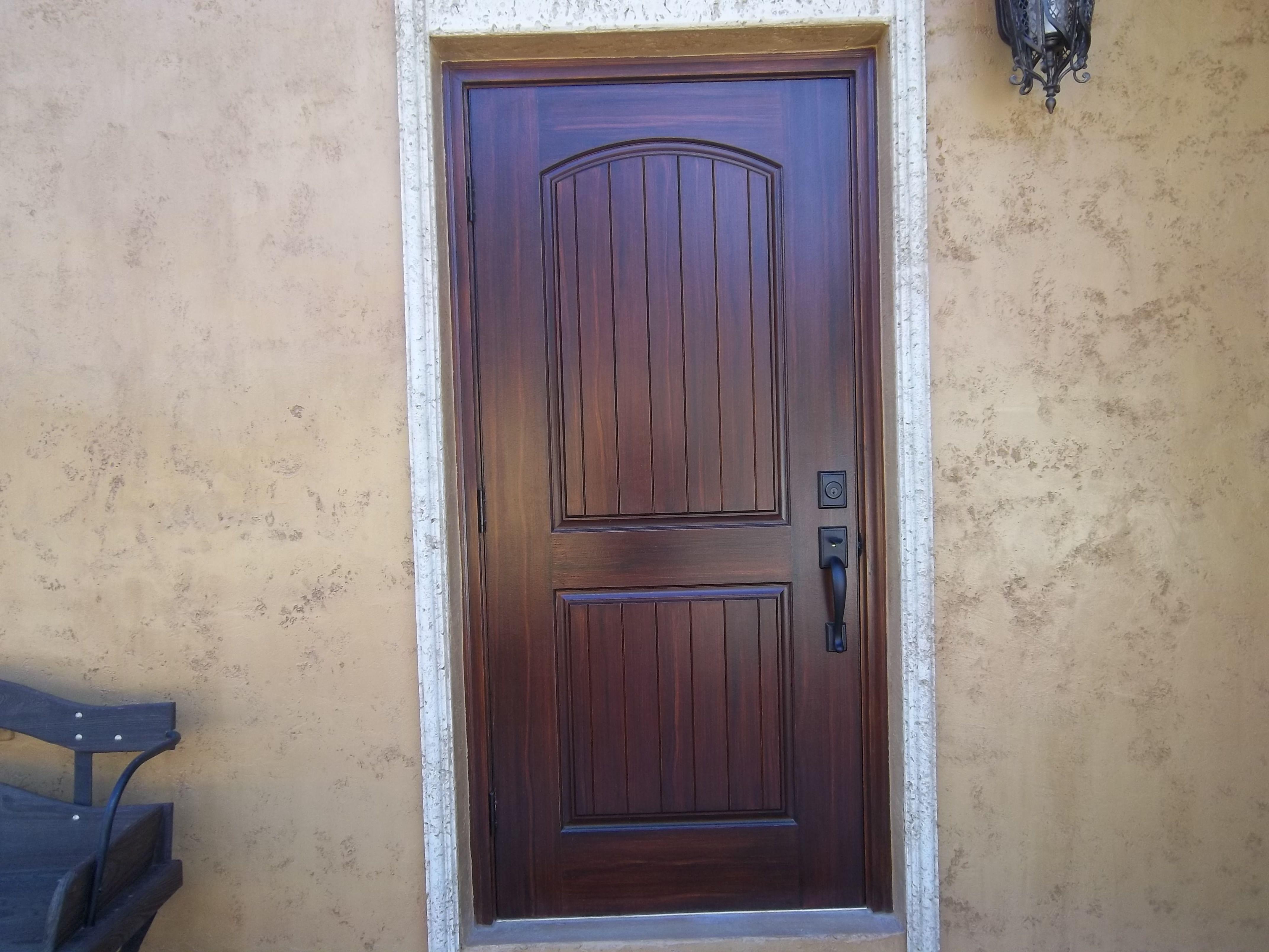 Wood exterior doors and faux wood front door retirement for Mediterranean style front doors