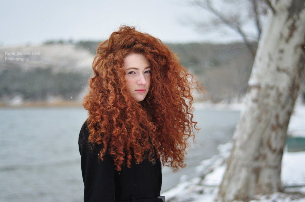 woman with curly red hair.