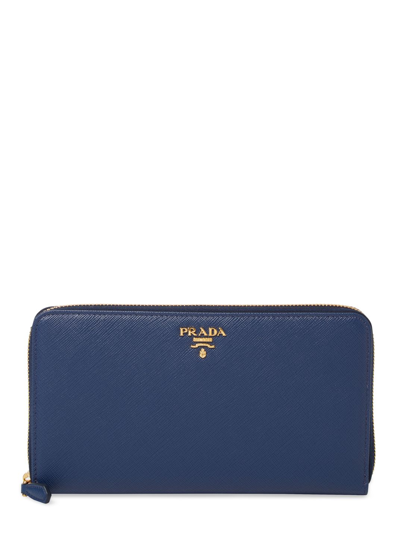 ca8321318e8061 ... free shipping prada womens saffiano leather zip around wallet dark blue  navy. prada a921e fbd2b