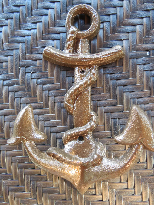 Cast Iron Nautical Anchor / Metal wall hook /Cast Bronze color/Bathroom hook / Coat Hanger/ Double wall hook/ Beach décor. $12.49, via Etsy.