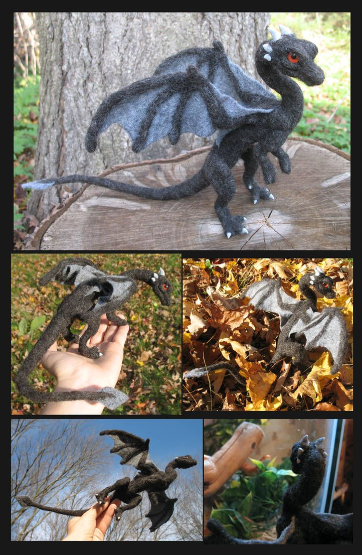 This needle felted dragon is made of soft black wool. His wings and tail fan are charcoal grey felt, and his face is set with red glass eyes. A wire skeleton is run through him through nose to tail... #feltdragon