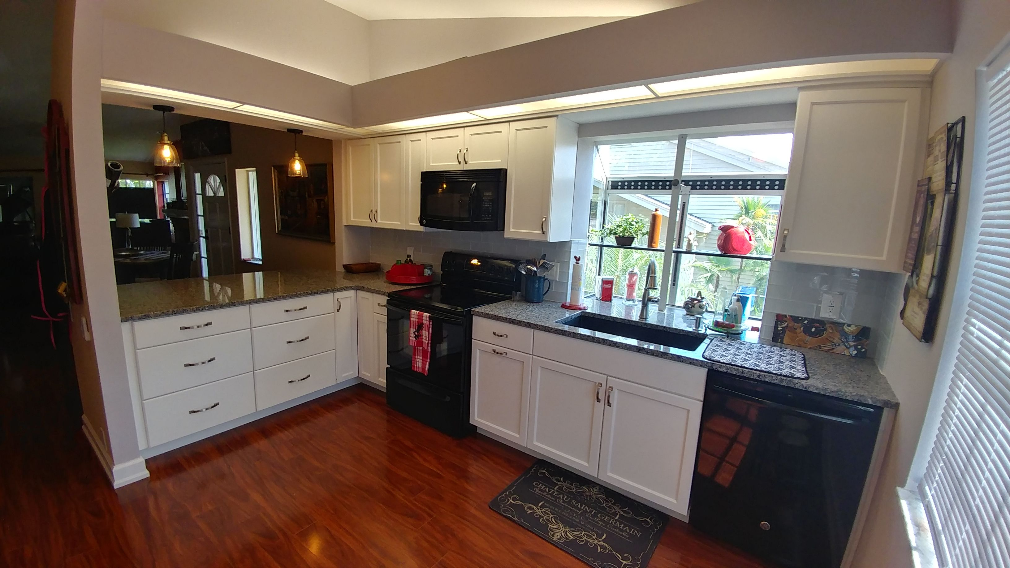 We Created A Seven Foot Pass Thru To Open Up The Kitchen To The Rest Of The Condo White Recessed Panel Cabinets With Images Black Appliances Glass Subway Tile White Glass
