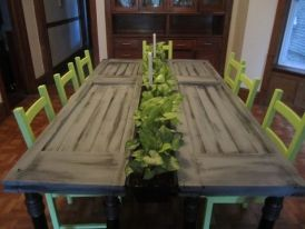 Living dining table... combines both reclaimed materials and living plants to create interactive art and a place to share a meal. This design is made from reclaimed vintage doors and the runner of the table is made from living plants. Planters are removable for watering or replanting if necessary. neat.