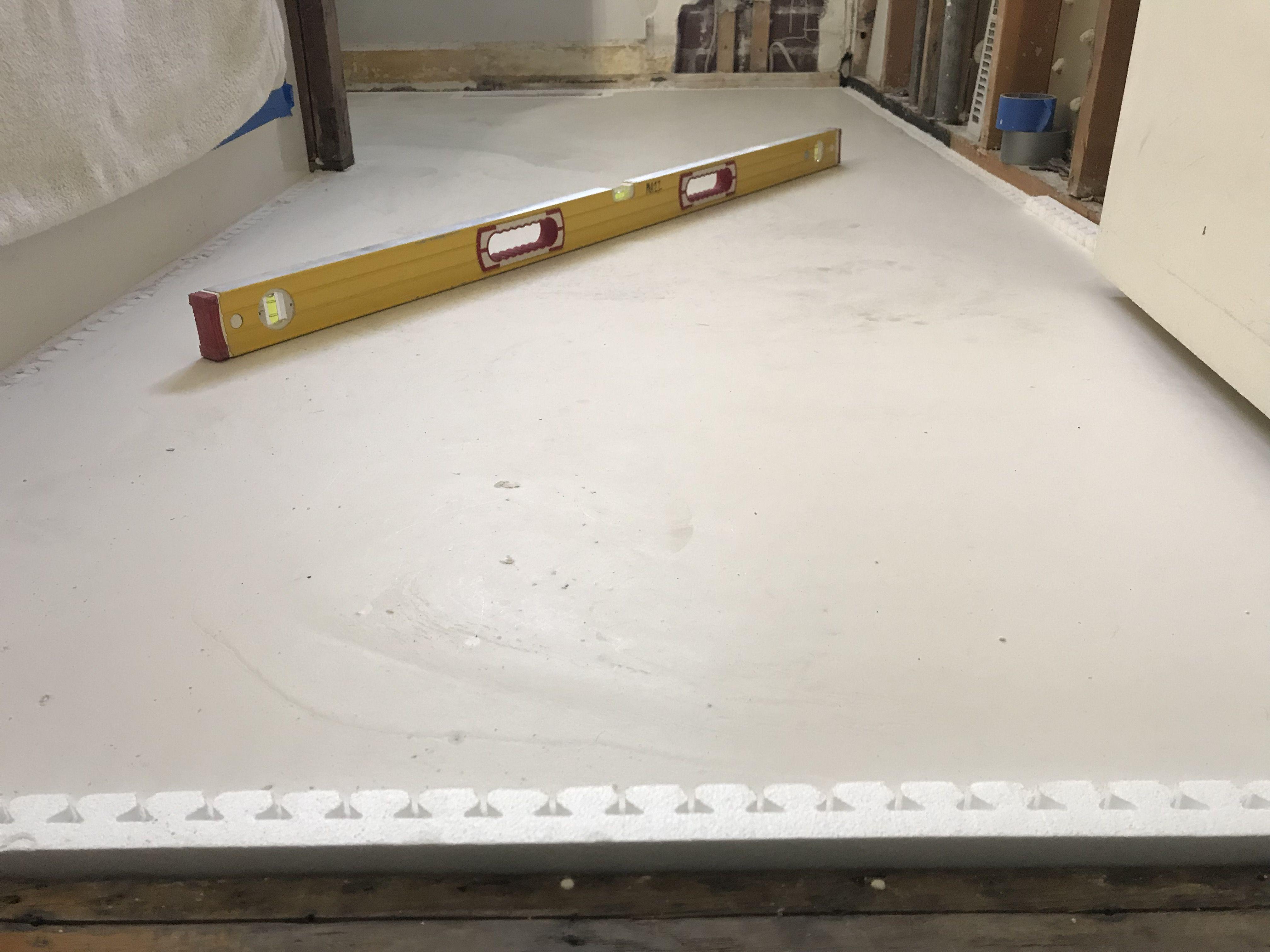 Pour Self Leveling Underlayment To Level And Smooth A Floor Before