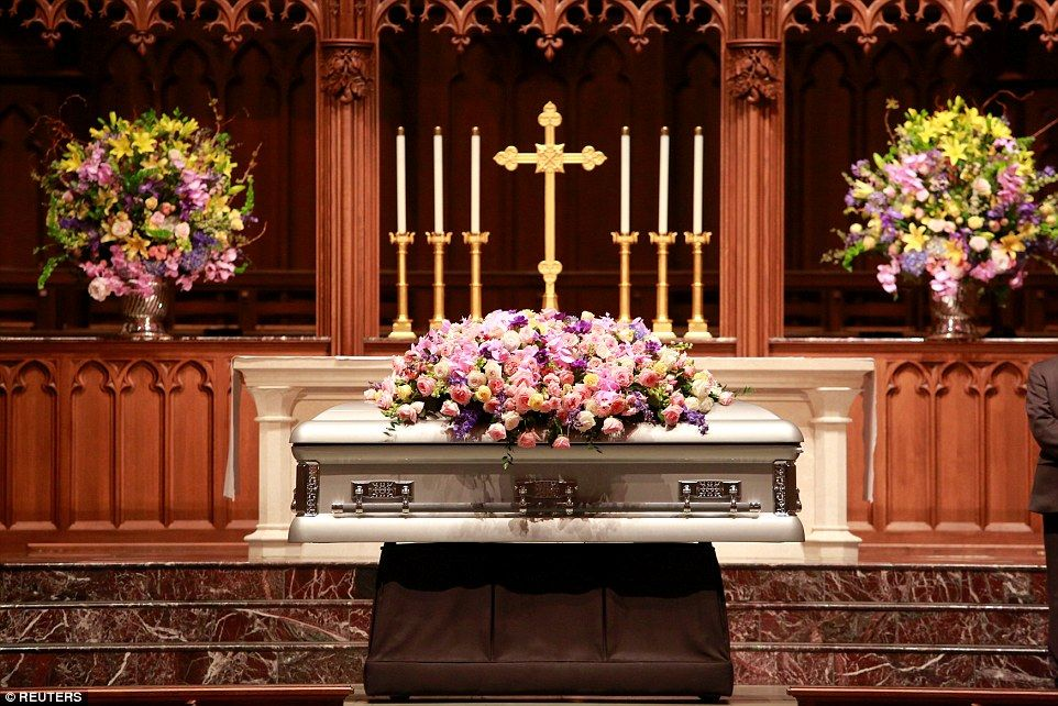 H. W. Bush sits by Barbara's coffin and greets
