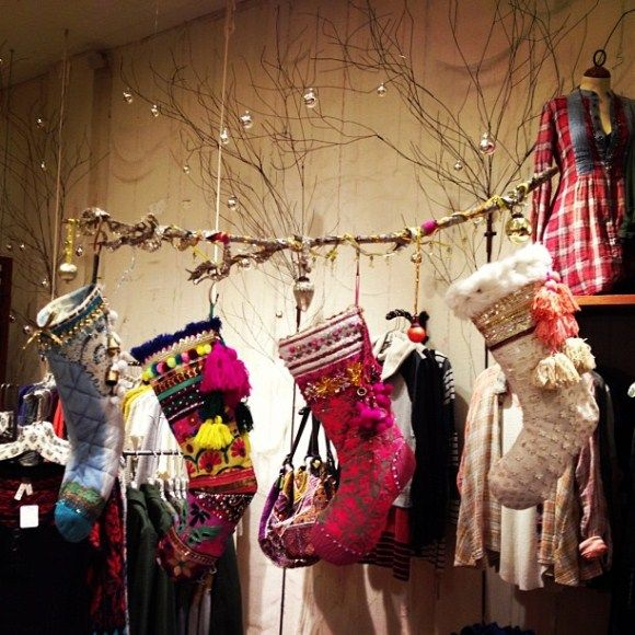 Carolers Displayed On A Mantle With Garland And Stockings: A Peek At Our Holiday Store Displays
