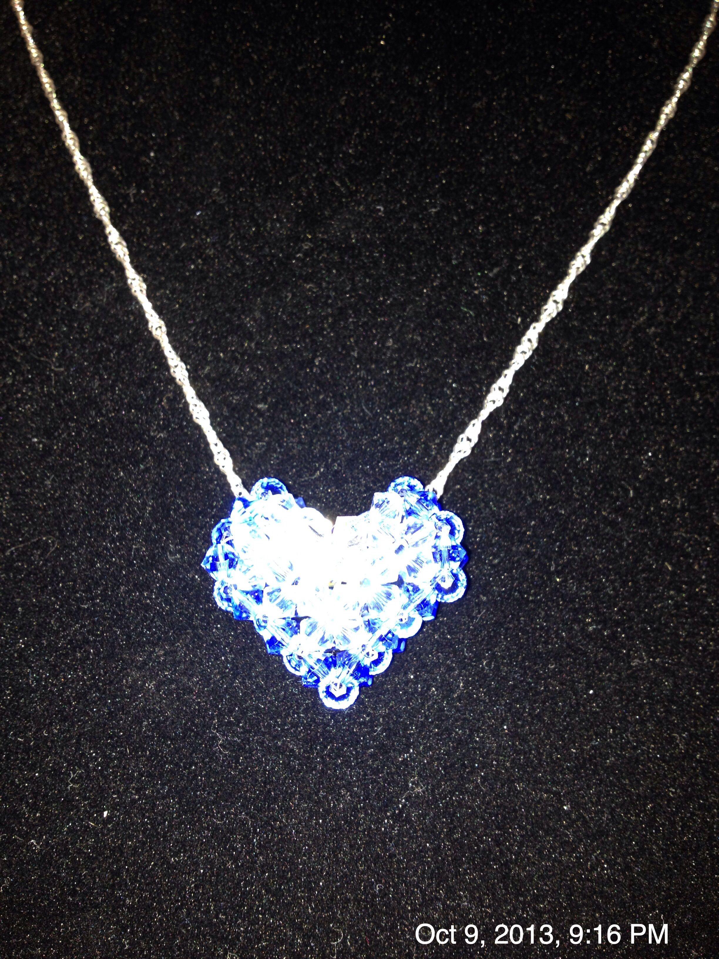 Swarovski crystals.Dark blue to light blue to crystal center