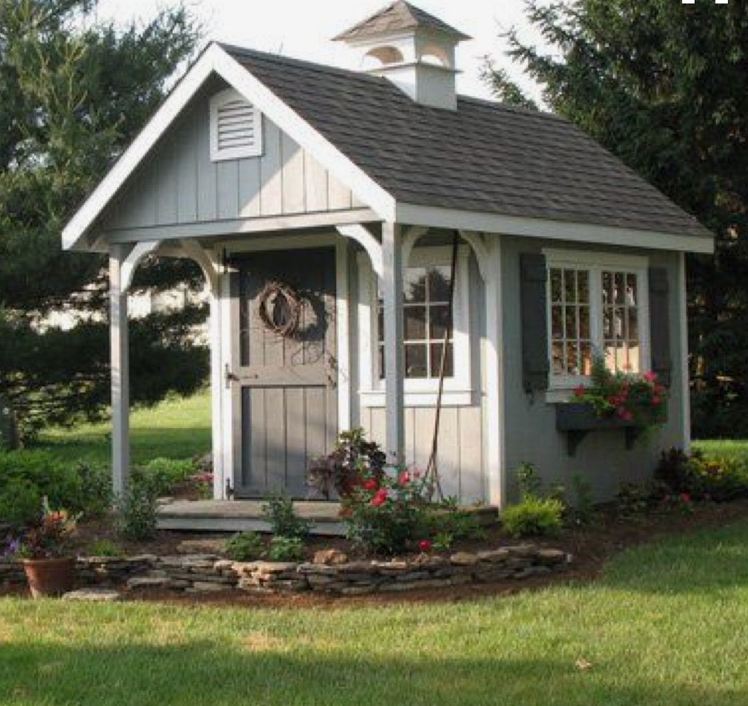 Love the colors of this garden shed. Backyard sheds