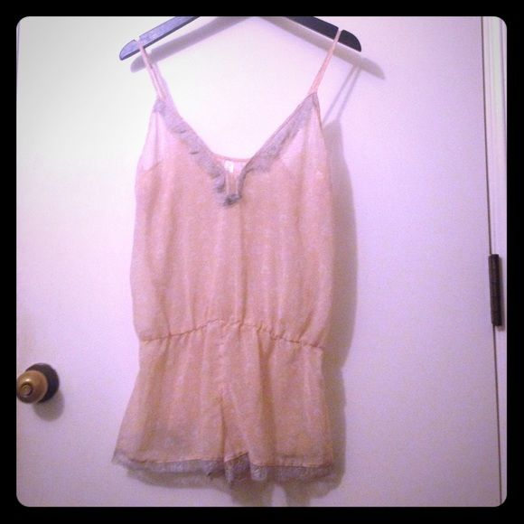 Blush pink and grey lace sheer lingerie Very sweet/sexy romper. Sheer and float. Tightens at waist. All over blush pink floral print with grey lace trim. Adjustable straps. This was given to me as a bridal shower gift, but it has never been worn. Perfect condition! Gillian Intimates & Sleepwear Chemises & Slips