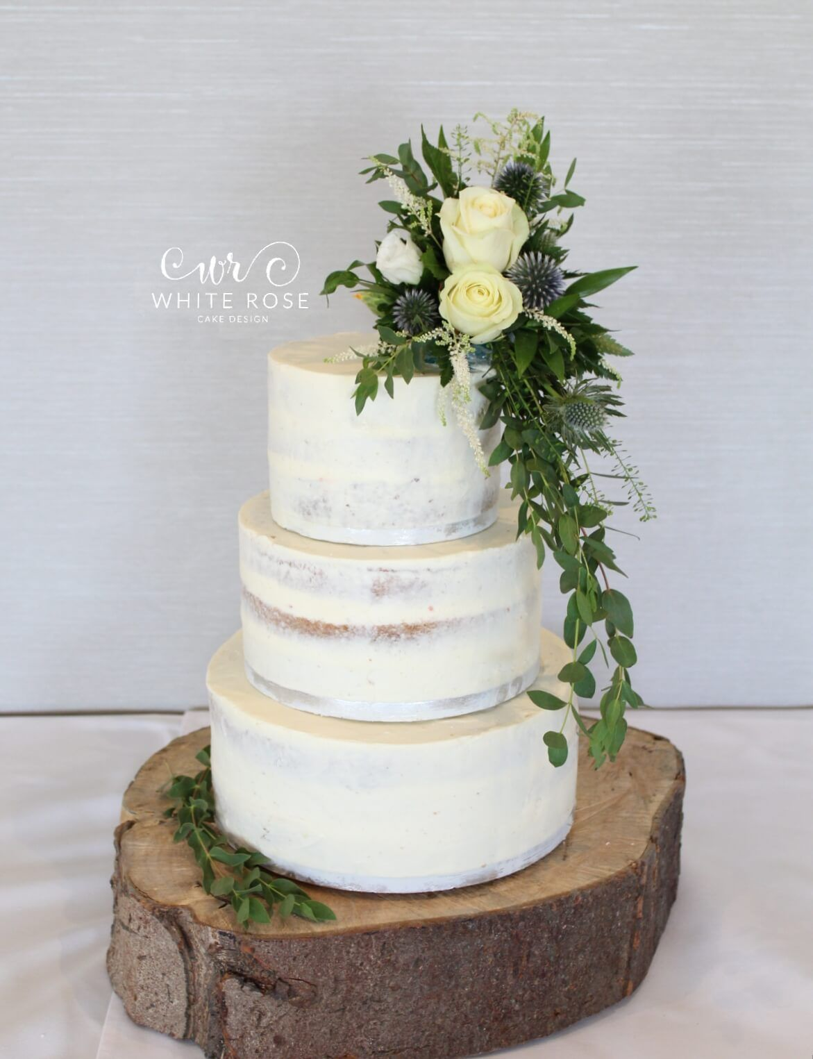 Rustic Semi-Naked Wedding Cake with Fresh Flowers at The Fleece Inn ...