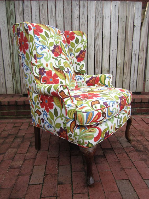 The wild side of me loves this wing back chair. Great pops of color that actually work in my not wild or bold house. $565.00 on Etsy. Ships for 125.00
