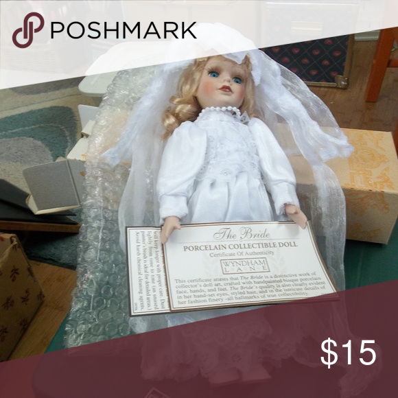 12 Porcelain Collectable Bride Doll This pretty Bride doll is 12 tall.  It has hand painted bisque porcelain face, feet  and hands.  By Wyndam Lane.  New in box, never been displayed. Wyndam Lane Accents Decor #bridedolls