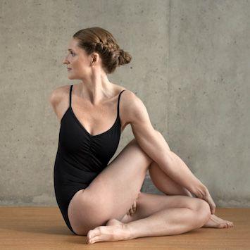 woman doing spinal twisting pose bikram yoga pose  health