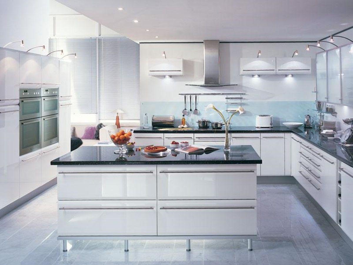 futuristic white kitchen interior set with black granite
