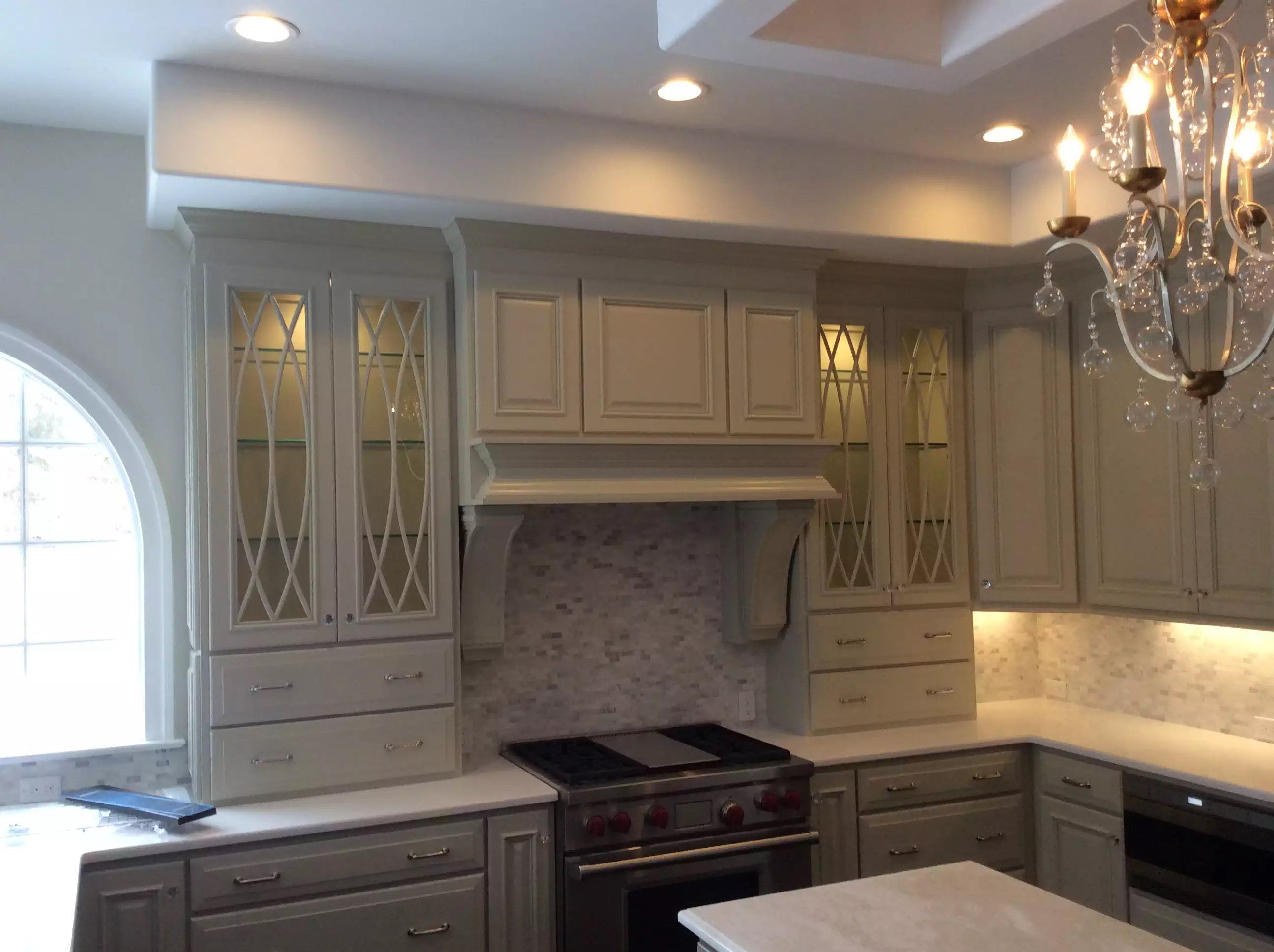 Grey Painted Kitchen Cabinetry And Hood With Arched Paned Glass Fronted Cabinet Doors Grey Painted Kitchen Kitchen Cabinetry Cabinetry