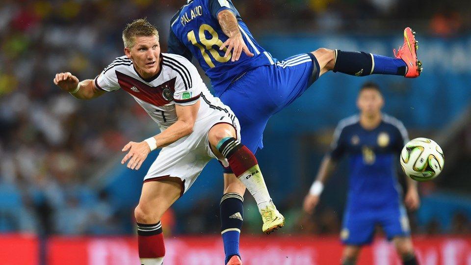 Bastian Schweinsteiger Of Germany And Rodrigo Palacio Of Argentina Compete For The Ball Fifa Schweinsteiger World Cup