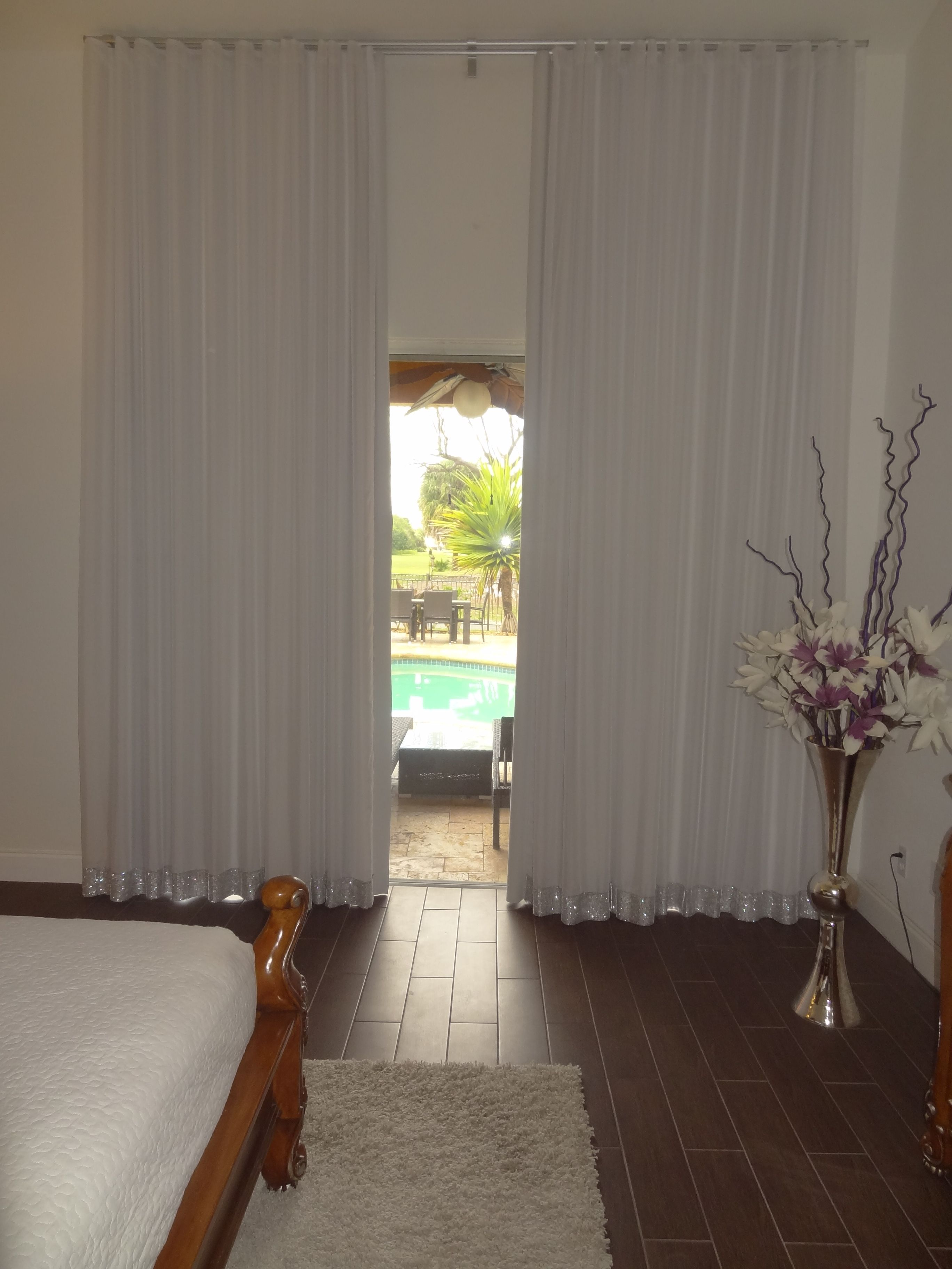 Custom ripple fold sheer drapes and a second layer of blackout lining.
