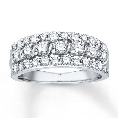 Colorless Round Diamonds Shine Within Swirls Of 14K White Gold Bordered Above And Below By Additional In This Exquisite Anniversary Band For