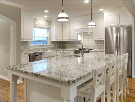 White cabinets, grey subway tile backsplash and bellingham-esqe countertop