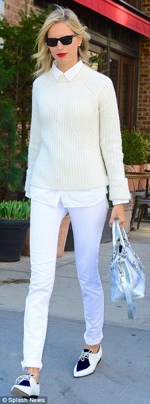 Professional chic: The former Victoria¿s Secret Angel sported a thick knit sweater over a collared button-up shirt, highlighting her long sl...