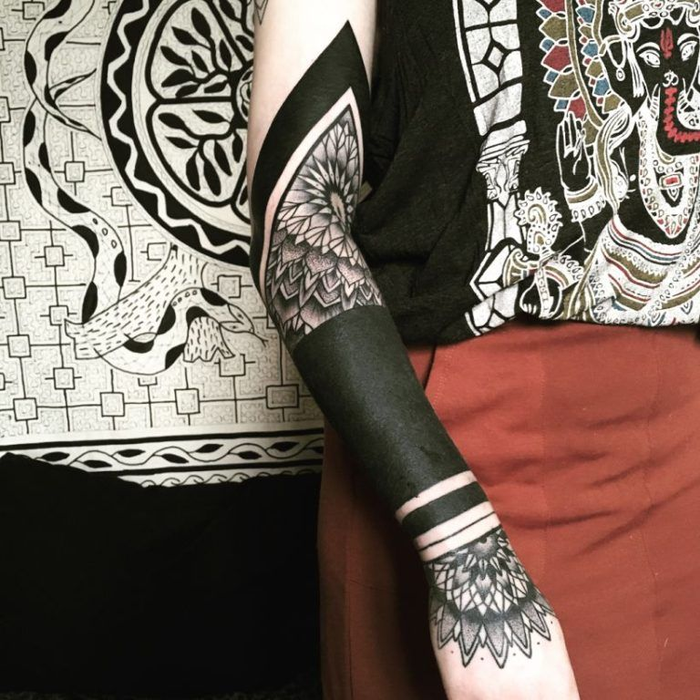 These Striking Solid Black Tattoos Will Make You Want To