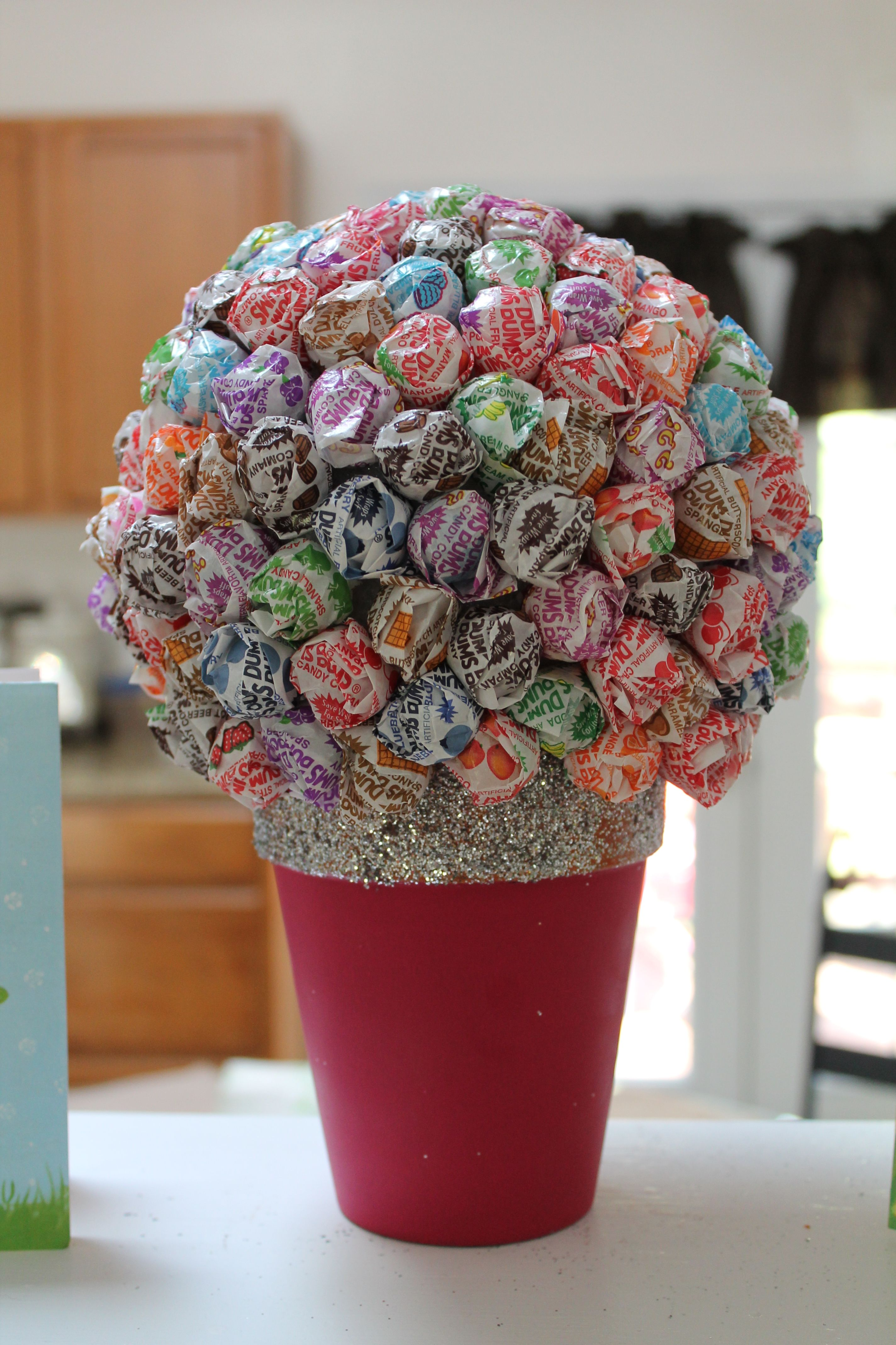 Dum Dum Lollipop {Flower Pot} Someone i know made somthing like this ...