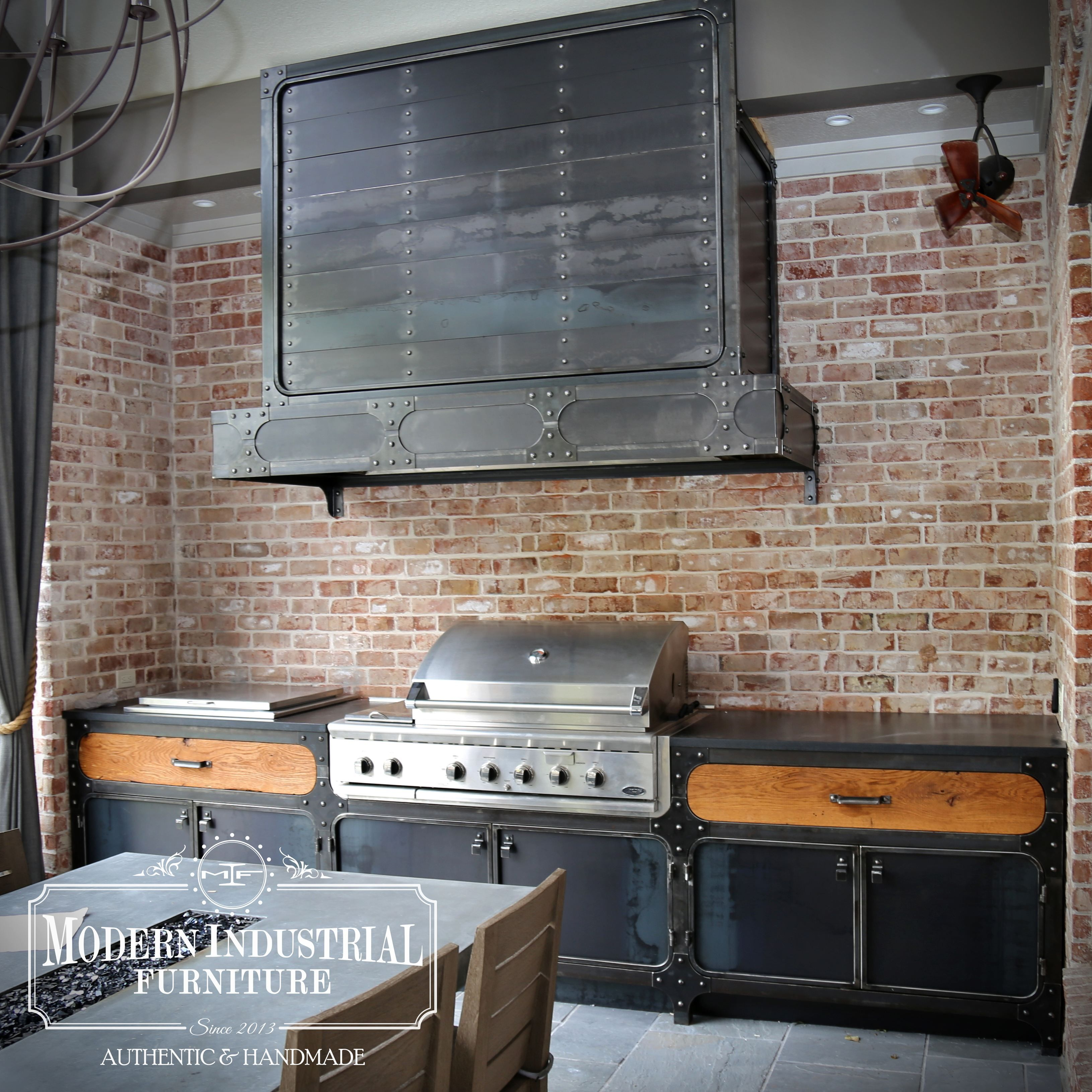 Custom built industrial style outdoor kitchen with range