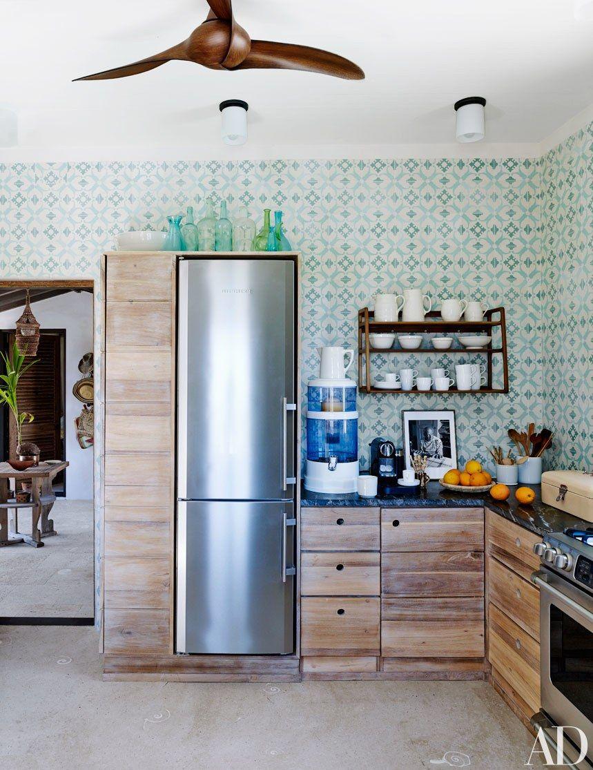 A slender refrigerator-freezer by Liebherr fits into the kitchen\'s ...