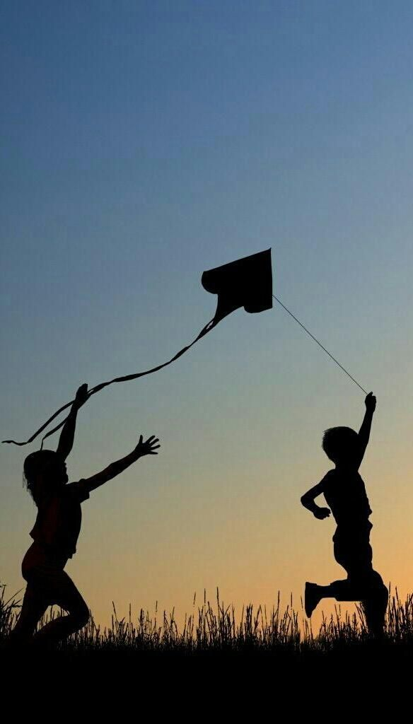 Two Kids Having Some Kiting Fun In The Evening Air An Elegant Visual Expression Of The Joy Of Flying Kites Silhouette Photography Silhouette Art Photo