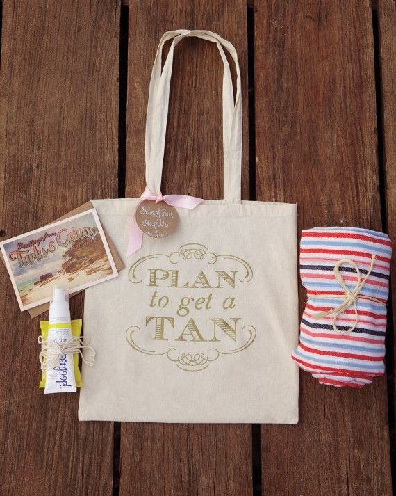 At this Turks and Caicos celebration, attendees received a bag stocked with a welcome booklet, striped beach blanket, and sunscreenfrom bride and groom Anne and Josh.