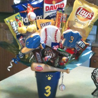 06903cf284862d Baseball Candy Bouquet ...I made these for Senior Night as gifts to the  Seniors! The cap, baseball, and numbered shirt are cookies.