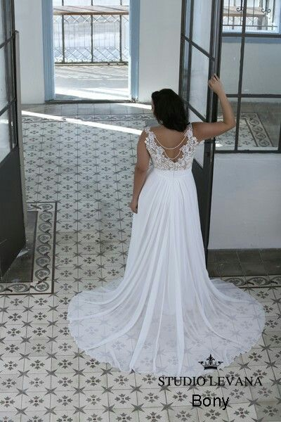 Open back lace plus size wedding gown with a see through chiffone ...