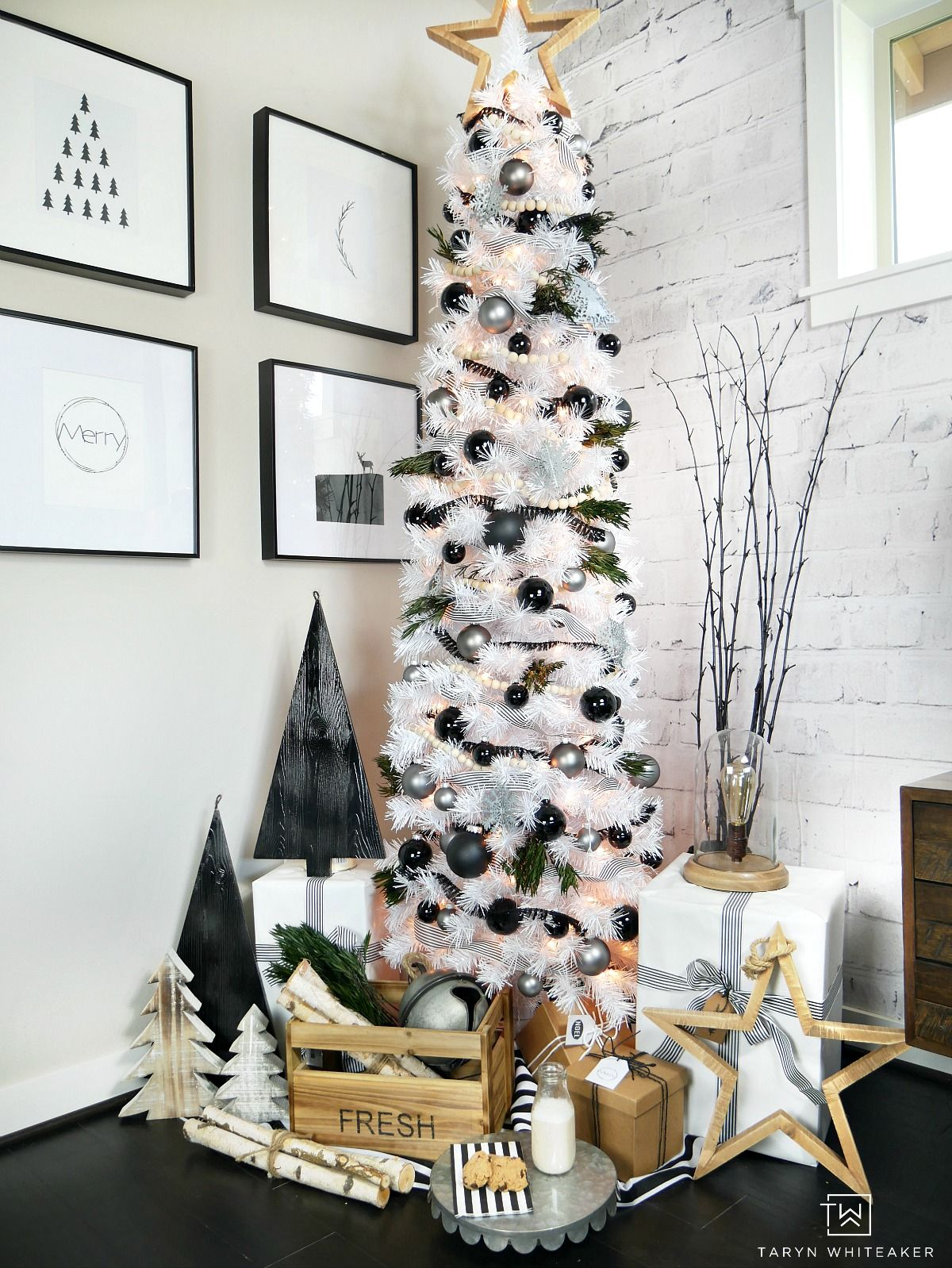 Taryn creates this Modern Black and White Christmas Tree display in her  home using a tall
