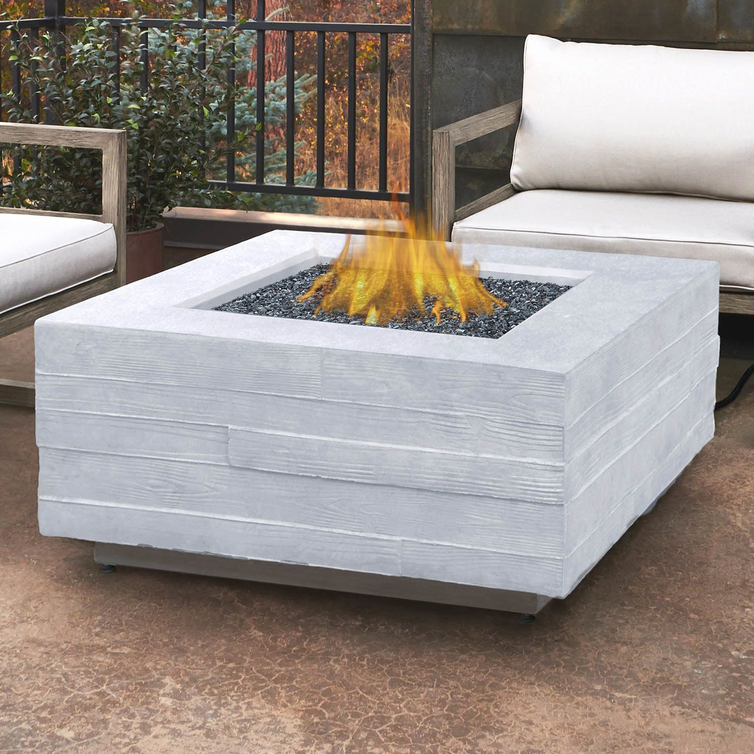 Board form concrete propane fire pit table in back yard