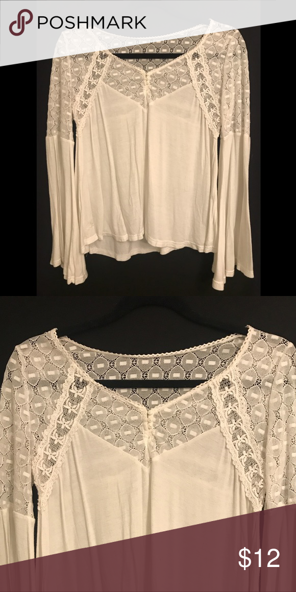 86616ffbdc9 Women s Sheer White Laced Bell Sleeved Boho Top White flowy top with bell  arms and laced shoulder and chest accents. Beautiful and classic.