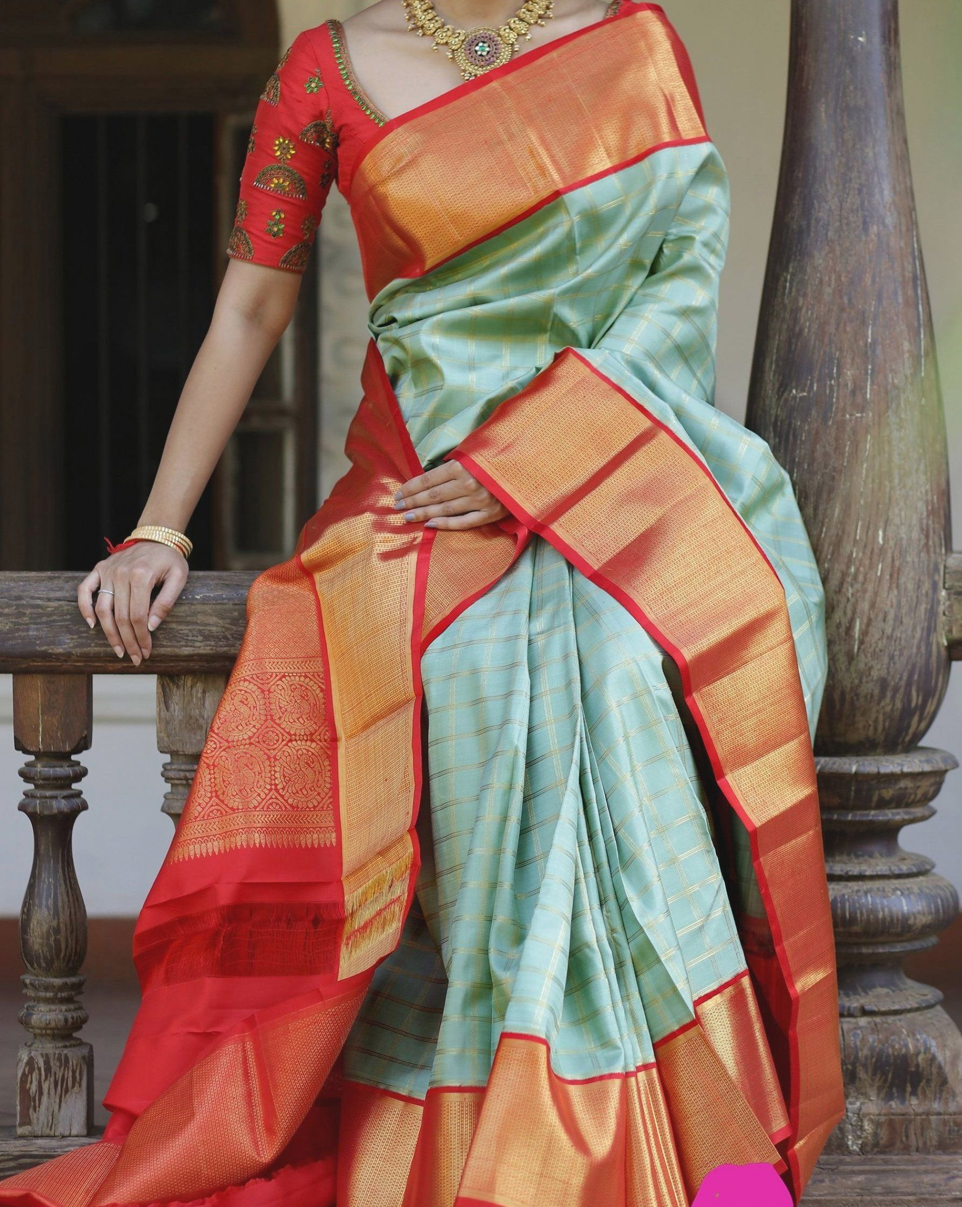 Kanjivaram silk saree in pista green  handwoven with gold zari kattam patterns all over  completed with a beautiful red border in intricate weaving  and a heavily woven pallu in red with gold zari patterns  Blouse  Red silk with coordinated borders #silksarees #designersarees #ethnicwear #westernwear #pattusarees #borderworksarees #jutefinishsarees #zariworksarees #utsavasarees #festivalsarees #occasionwear #fashion #traditional #handwoven #bridalsaree #boutique #shopping #store #buysareesonline