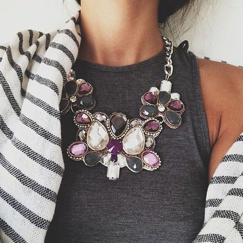 statement necklace on grey top with striped cardigan