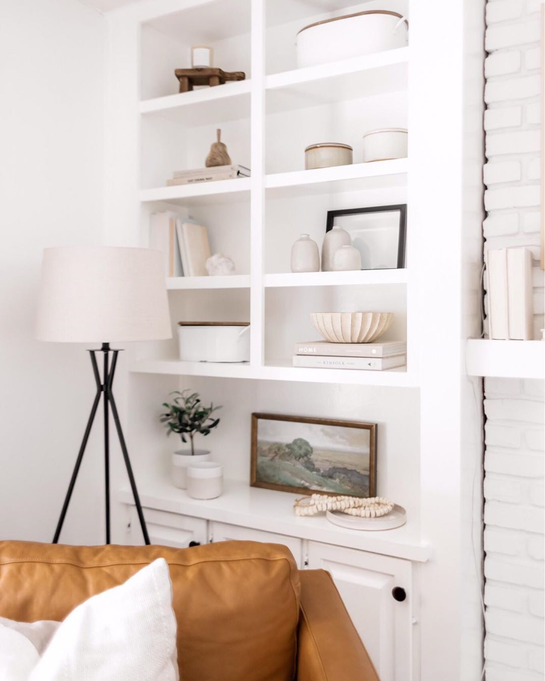 """Photo of KATIE STAPLES's Instagram profile post: """"Shelf Styling Motto: Use a monochromatic color scheme with varying tones and textures to create visual interest that makes the space feel…"""""""