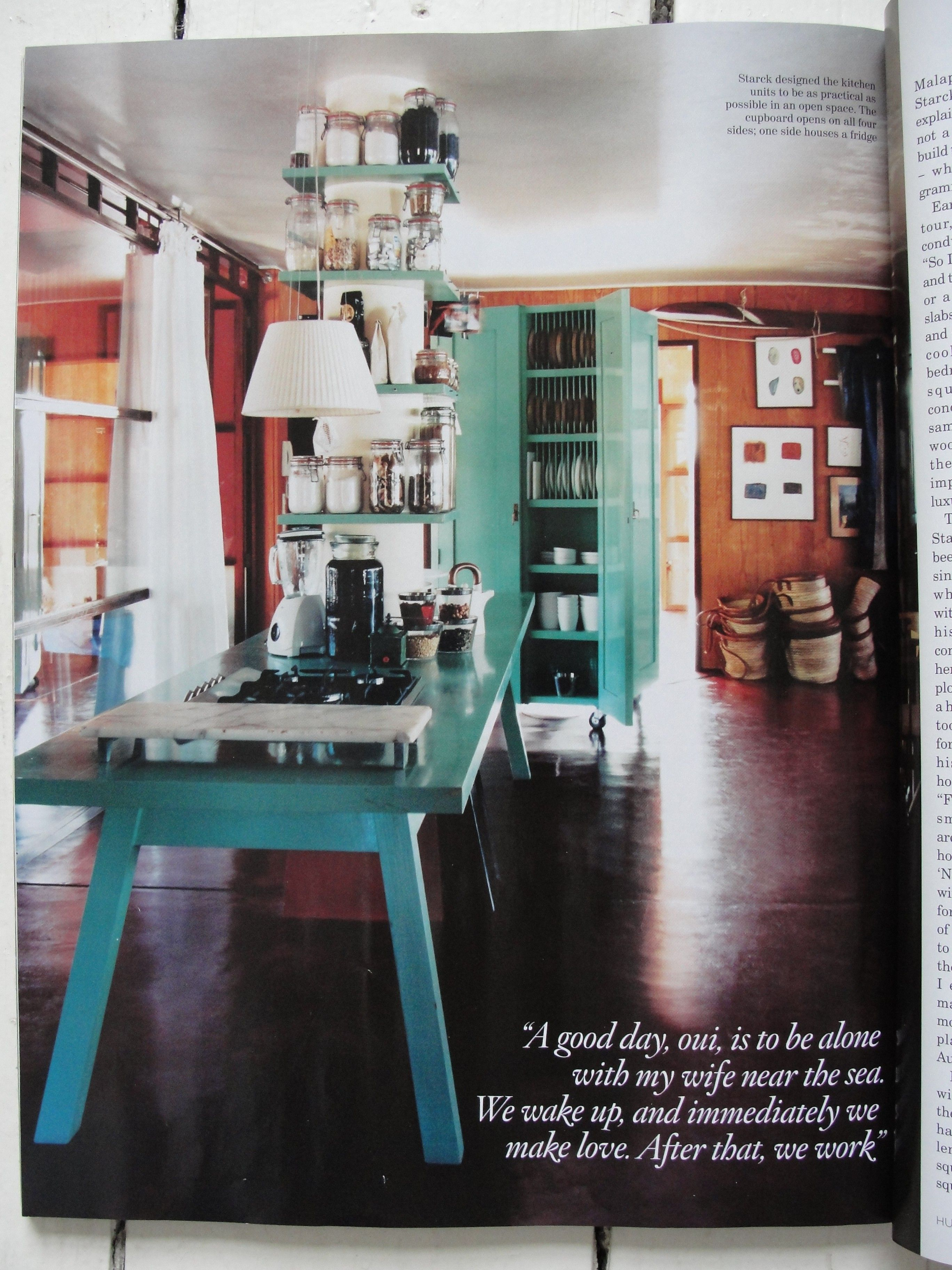 PLATE STORAGE inside!  also, Not-quite full height look: Philippe Starck's kitchen in his Balearic islands home