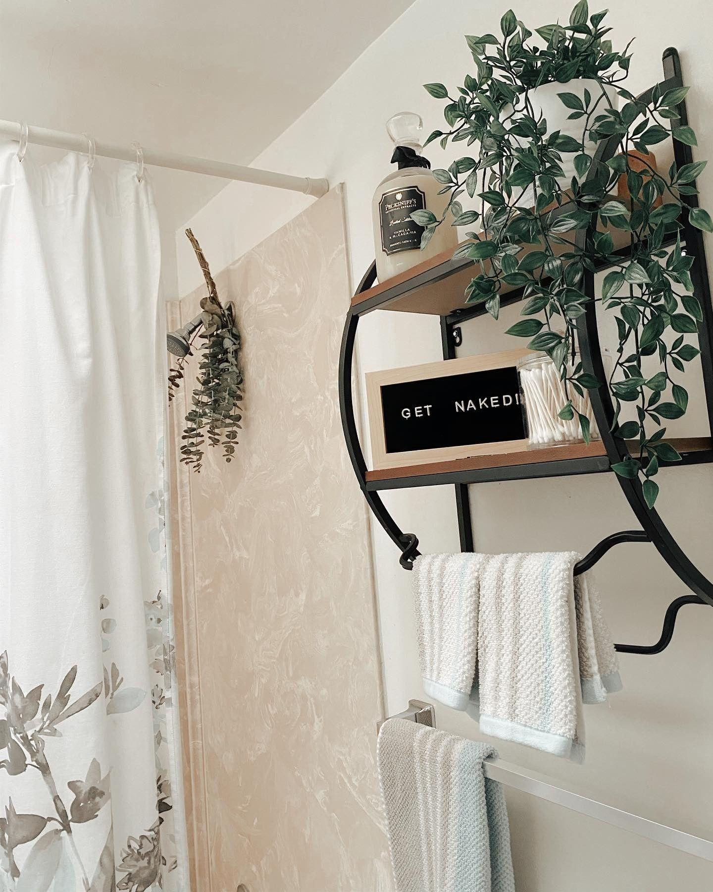 Fresh eucalyptus and an organized bathroom shelf are the perfect