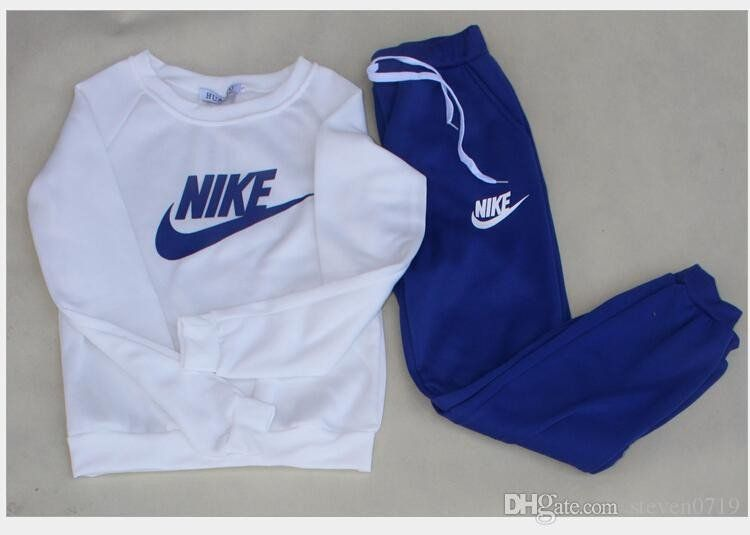 buy popular 90256 25eb9 Womens 2 PC Nike TrackJogging Suit - Loluxe - 4