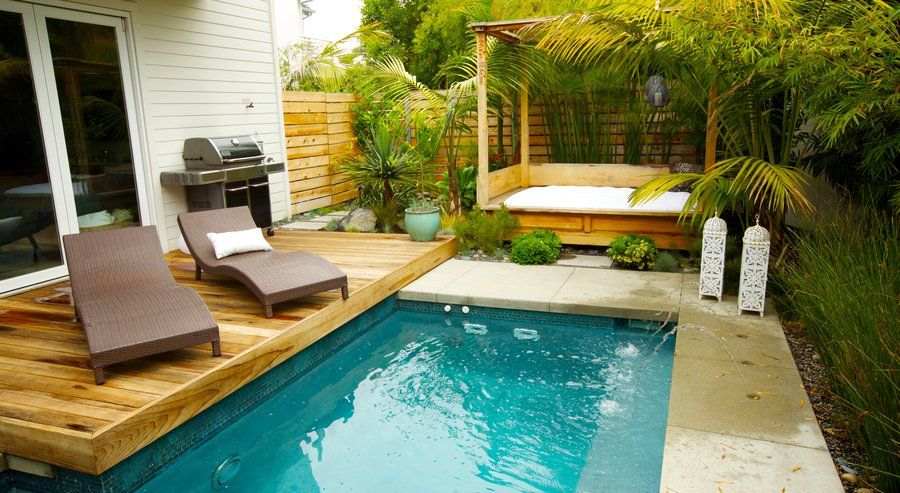 Outdoor Swimming Pool For Small Yard Design With Two Minimalist Chairs And Bed Around Mini Luxurious