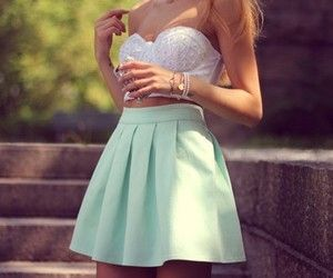 white strapless bustier with a light green flowy short skirt ...