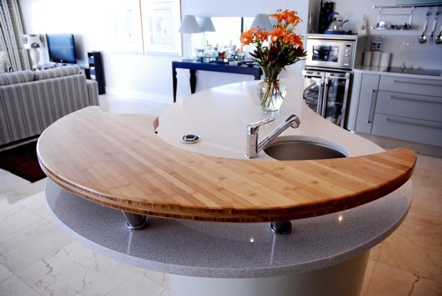this solid bamboo kitchen countertop is a beautiful feature. and