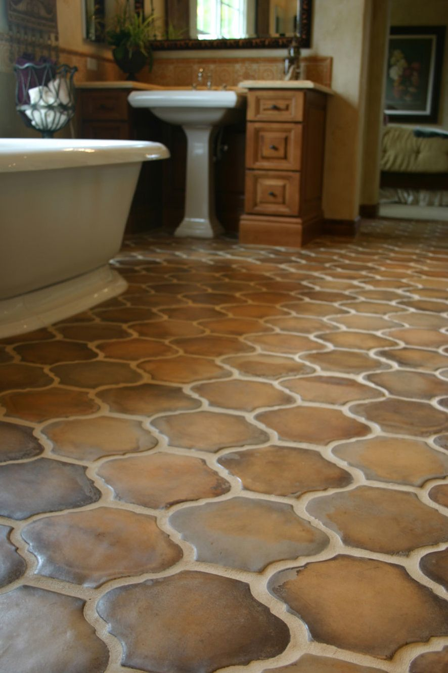 Multicolor brown terracotta floor tiles in a unique shape for Unusual bathroom flooring ideas
