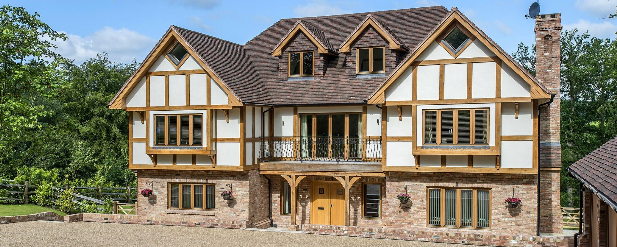 Traditional mock tudor style timber frame self build house for Timber style homes