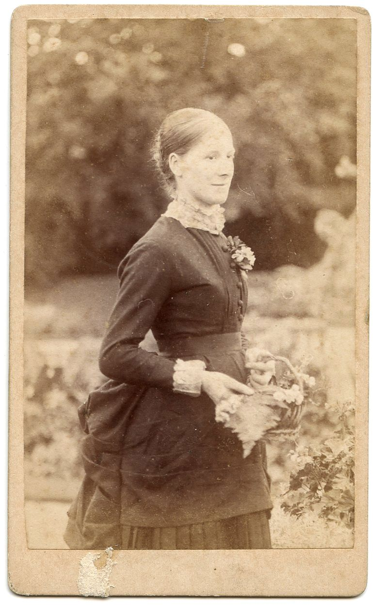 Romantic Outdoor Carte De Visite Of A Young Lady Holding Basket Flowers Lovely Blurred BackgroundOn The Reverse It Says From W Daynes Photo