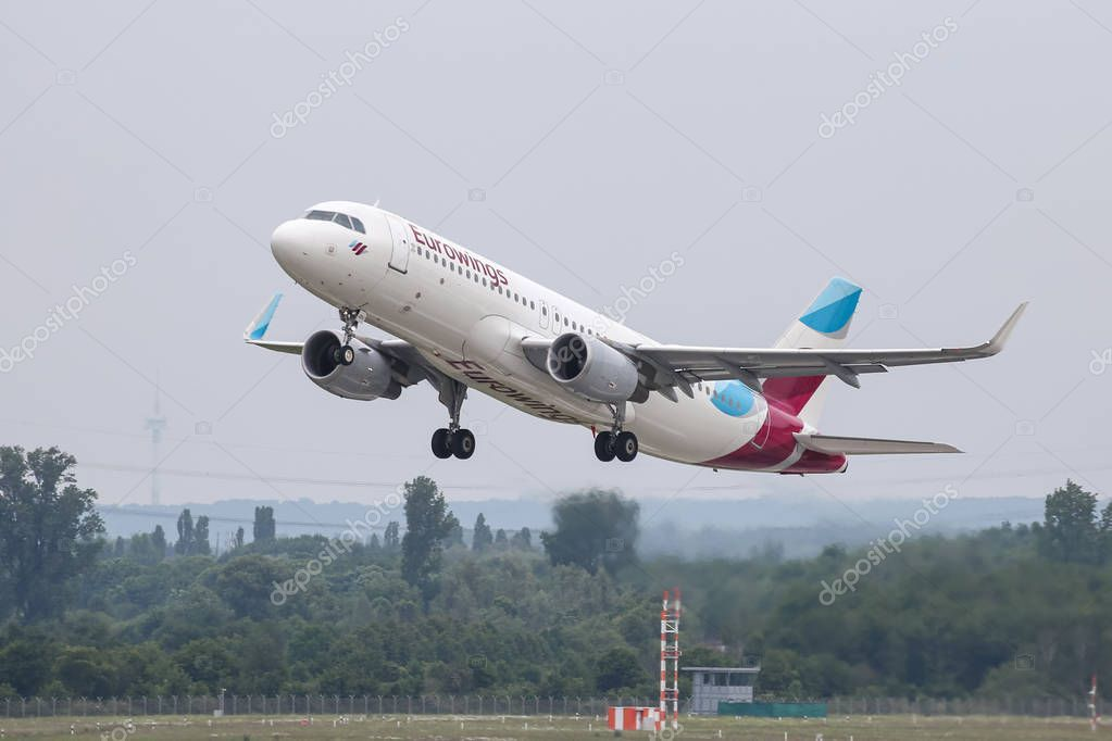 Airplane Takes off from Dusseldorf Airport Stock Photo